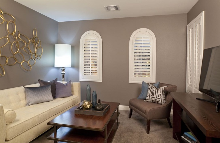 Sacramento family room with rounded plantation shutters.