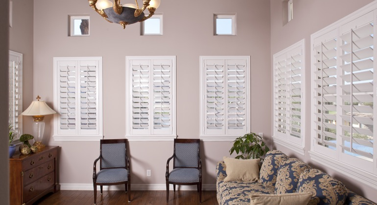 Chic sunroom with casement shutters