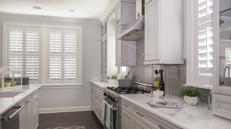 White shutters in Sacramento kitchen with modern appliances.
