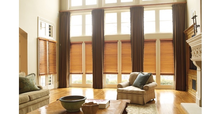 Sacramento great room with wooden blinds and full-length drapes.