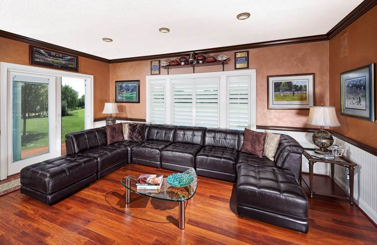 Sacramento basement with glass doors and plantation shutters.