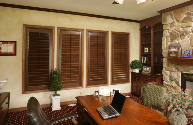 Wooden plantation shutters in a Sacramento home office