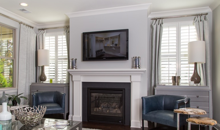 Sacramento fireplace with white shutters.