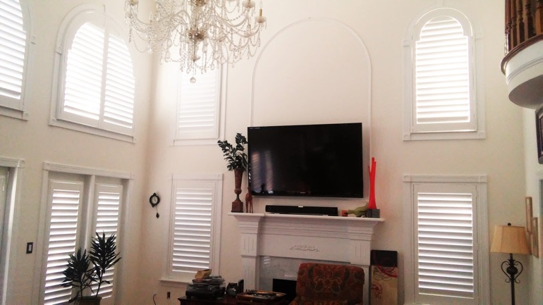 Sacramento Great Room With Mounted Tv And High Ceiling Windows