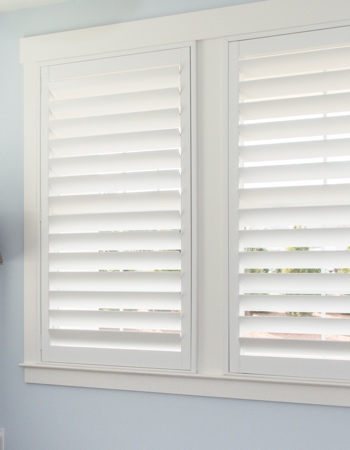 White plantation shutters with hidden tilt rods in Sacramento