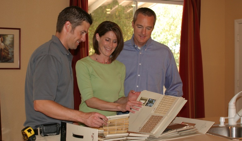 Homeowners viewing samples of window treatments.