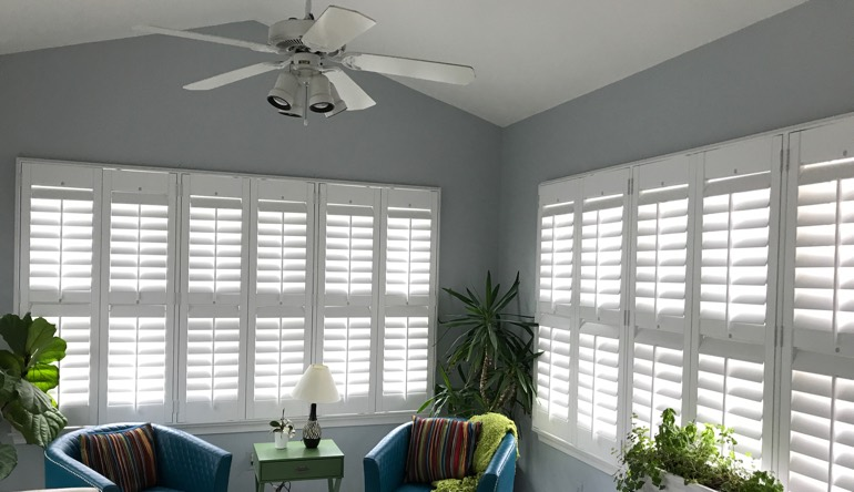 Sacramento living room with fan and shutters