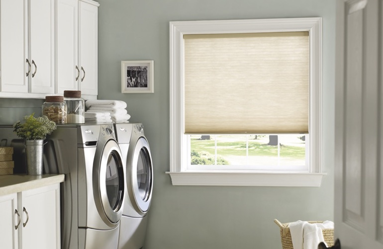 Sacramento laundry room with beige window shades.