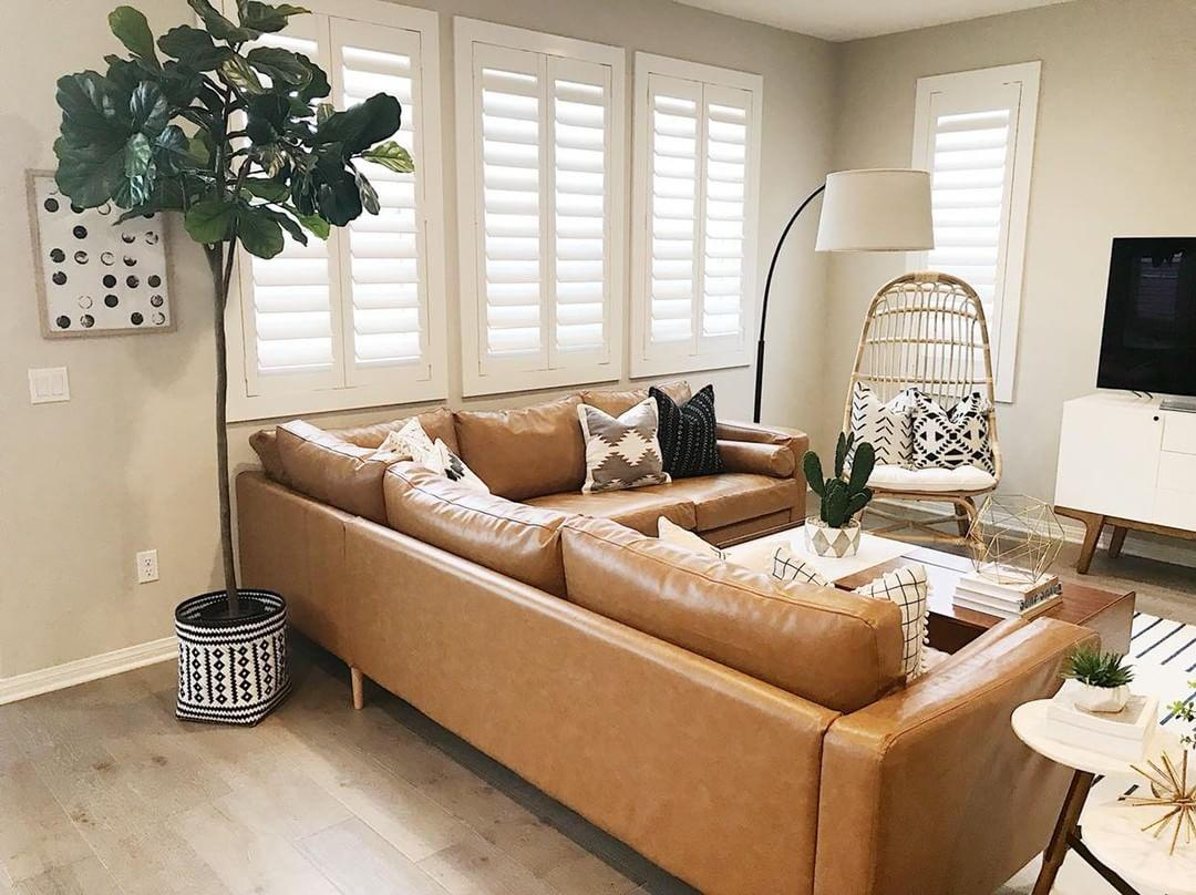Warm living room with our Polywood shutters in Sacramento.