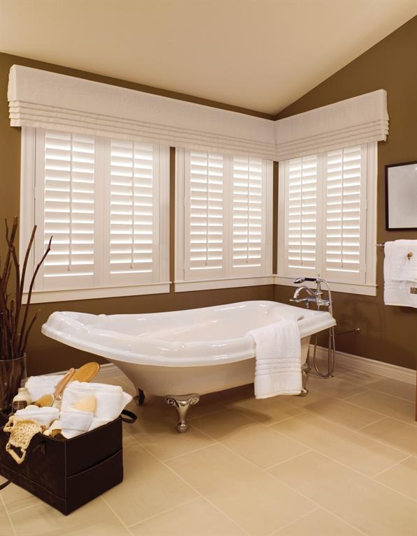 Plantation shutters in a brown bathroom