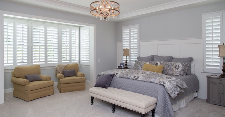 Plantation shutters in Sacramento bedroom.