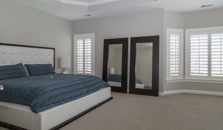White shutters in a minimalist bedroom in Sacramento.