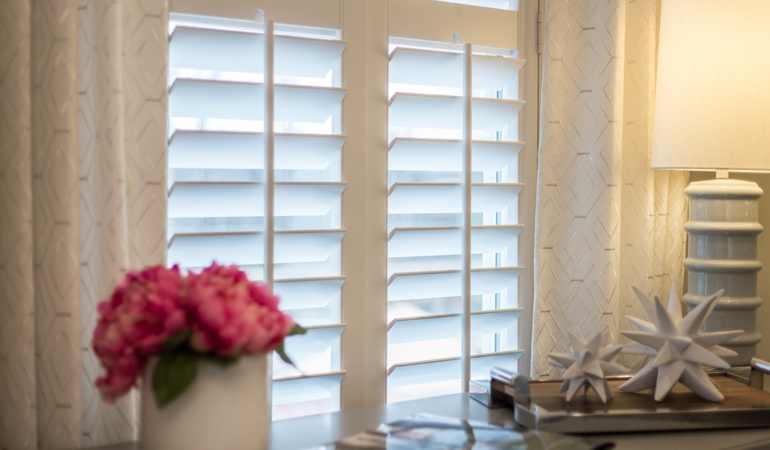 Plantation shutters by flowers in Sacramento