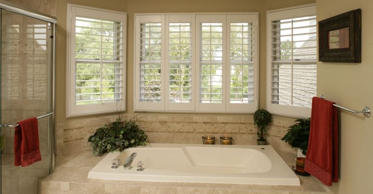 Plantation shutters in Sacramento bathroom.
