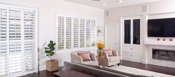 Sacramento living room in white with plantation shutters.