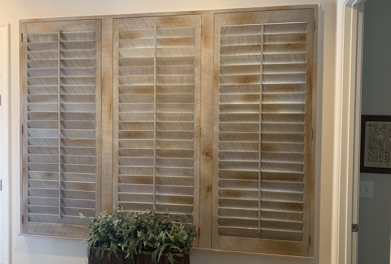 Closed reclaimed wood shutters in Sacramento