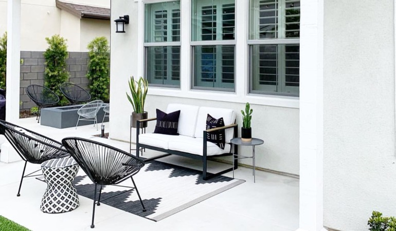 An outdoor with plantation window treatments