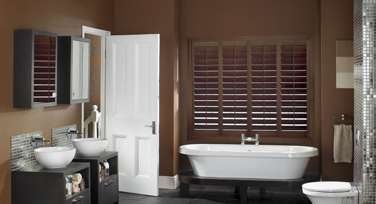 Stained wood shutter in Sacramento bathroom