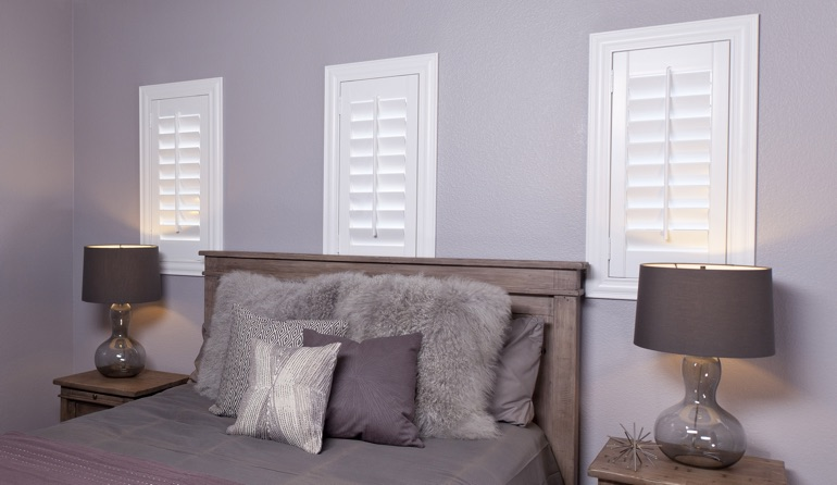 Studio plantation shutters in Sacramento bedroom windows.