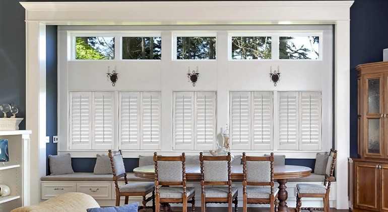Sacramento dining room with white plantation shutters.