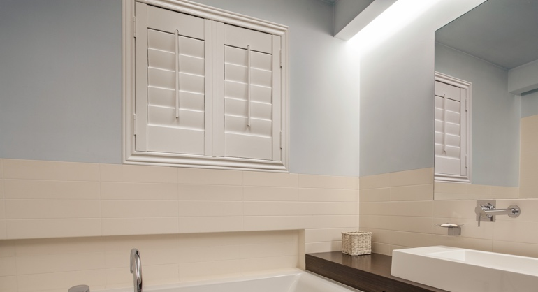 Plantation waterproof shutters in Sacramento bathroom.