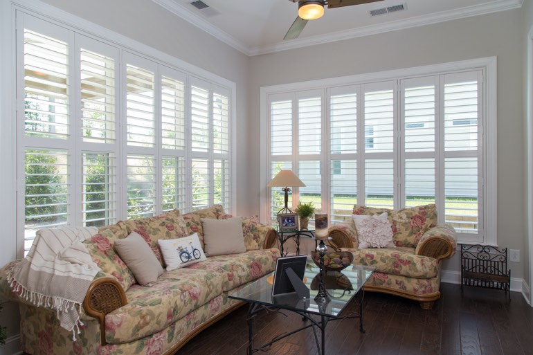 Sunroom with faux wood shutters in Sacramento.