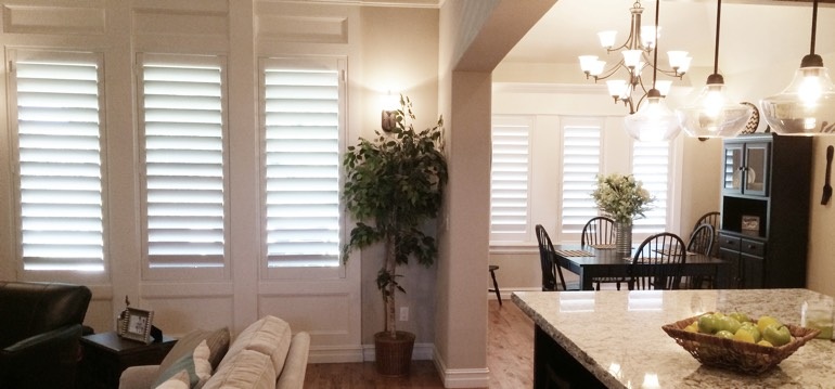 Sacramento shutters in dining room and living room