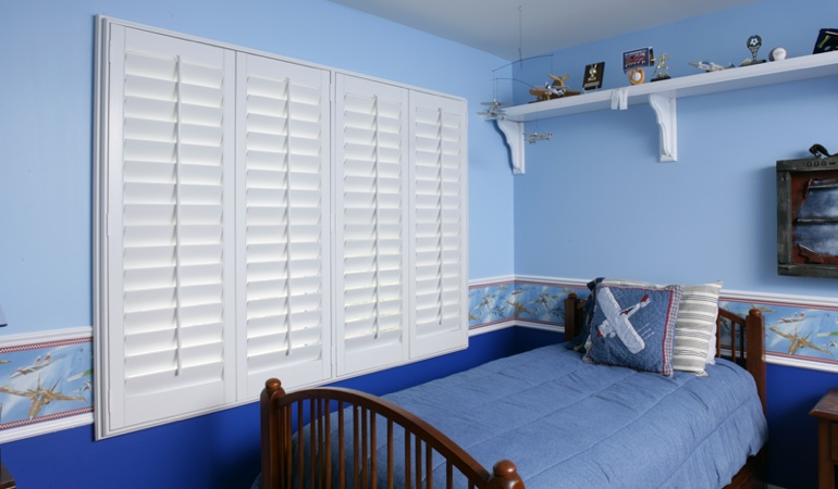 White plantation shutters in blue kids bedroom in Sacramento