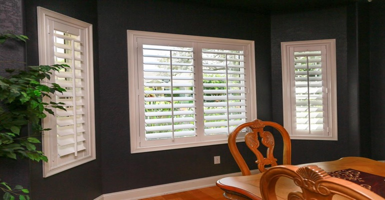 White Polywood Plantation Shutters In Dining Room With Dark Paint