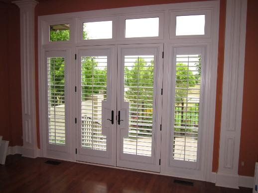 Sacramento patio door with sidelight shutters