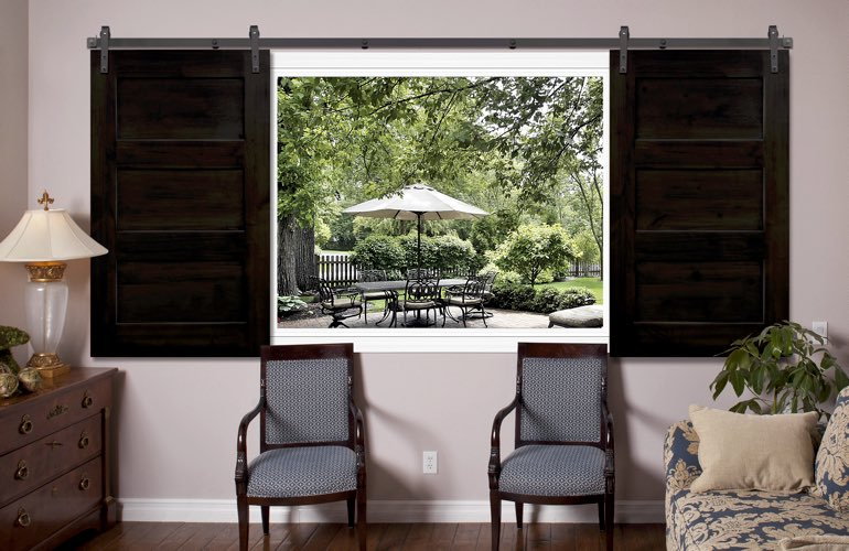 3 panel barn door shutters in family room