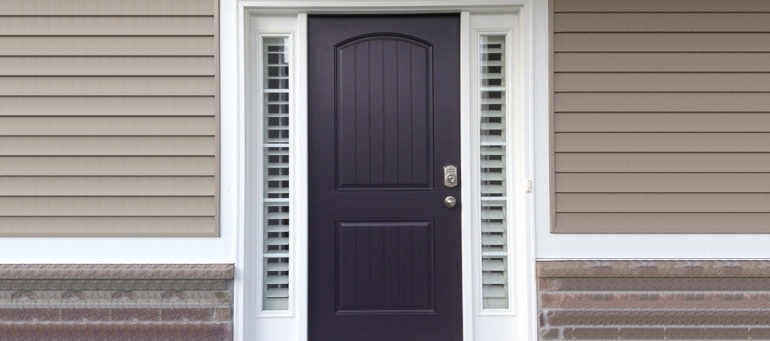 Entry Door Sidelight Shutters Next To Black Door In Sacramento, CA